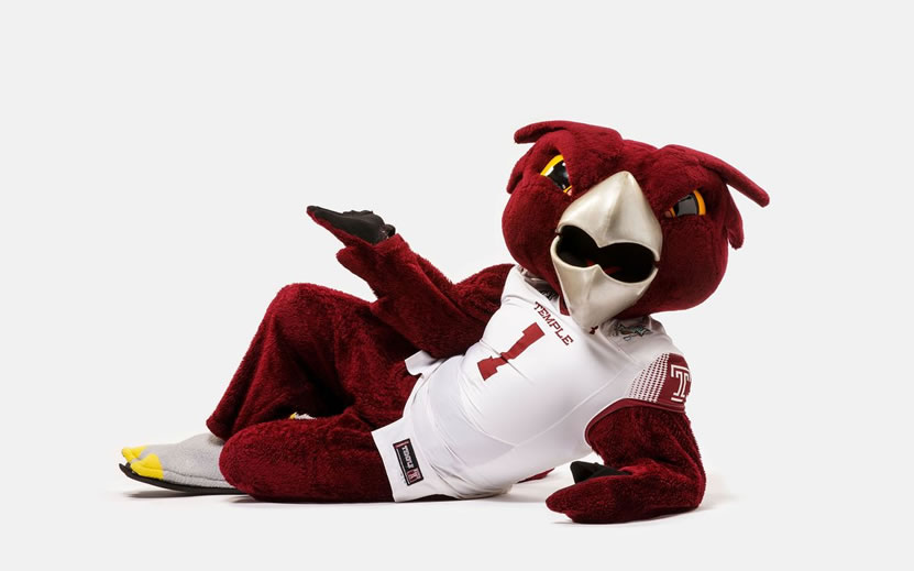Temple's Mascot Laying down hooter the owl