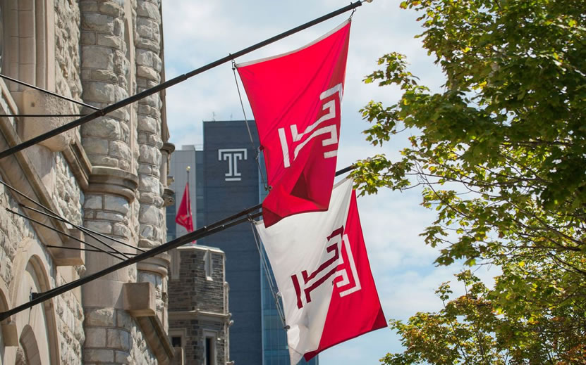 Temple T flags hang near Sulivan Hall