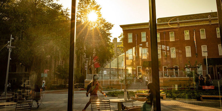 Shot from inside Charles library looking at a sunrise over Temple's campus