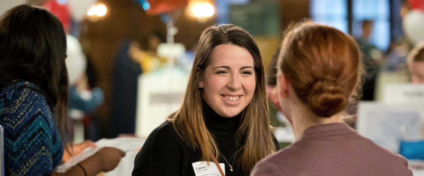 A pair of Temple students speak at a local job fair.