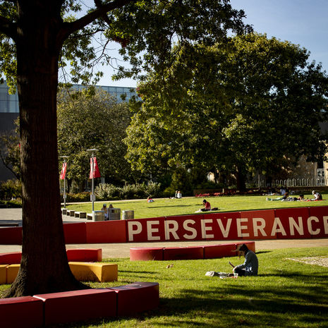 Sign with words Perseverance Conquers