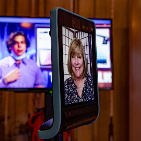 Amy Caples appears on the screen of a telepresence robot
