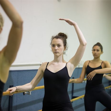 Student ballet dancers run through positions in a Boyer performance room at Temple