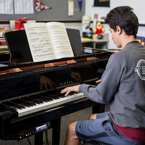 Temple student pianist practices on keyboard