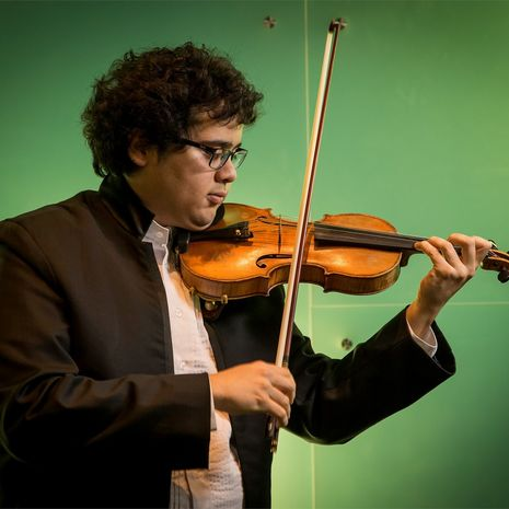 Temple student playing a violin solo