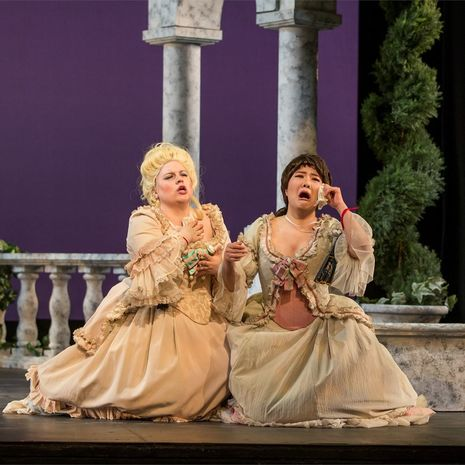 A pair of Temple opera singers perform on stage