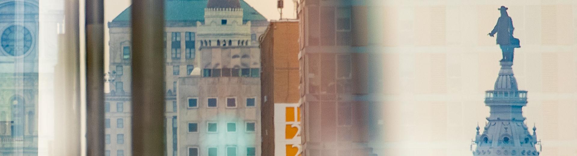 An abstract, layered image of the Philadelphia skyline