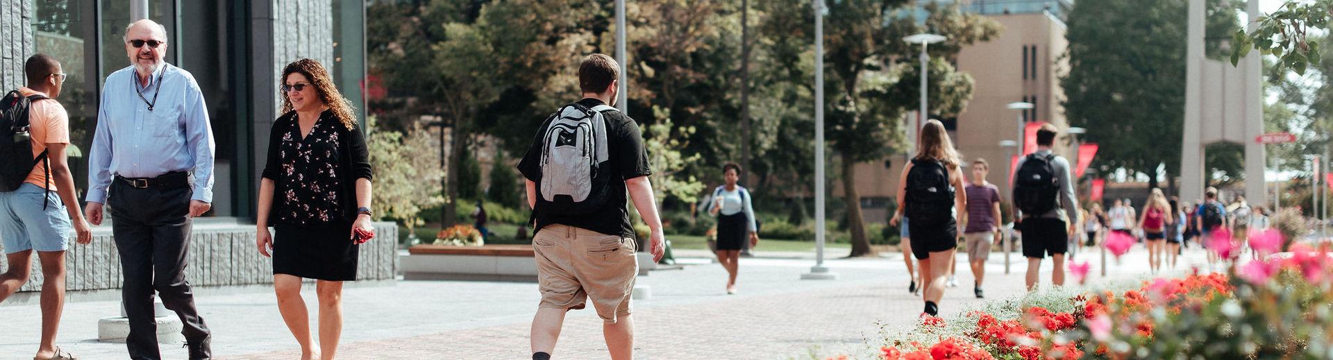 Temple students walk across Polett Walk between classes on Main Campus.