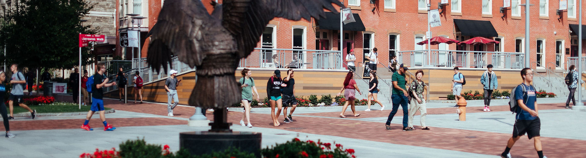 Students on Liacouras Walk on a sunny day.