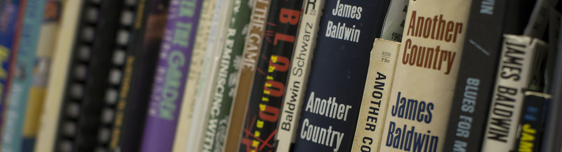 Books on a shelf in a library at Temple University