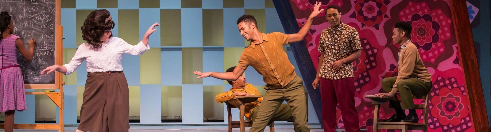 Actors dancing in Hairspray, the musical.