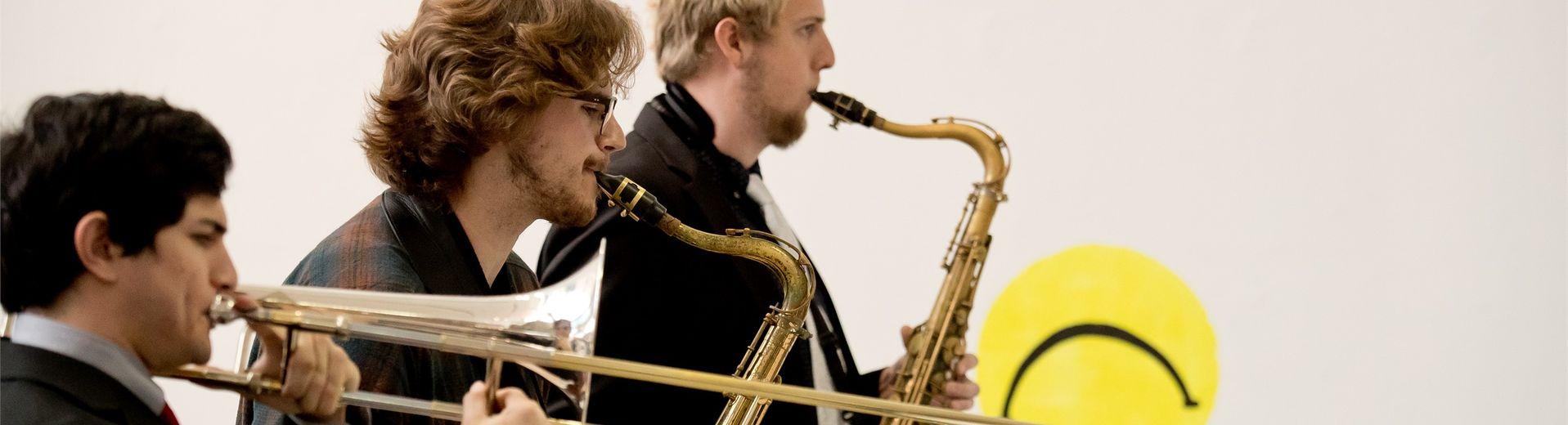 Three students playing saxaphones