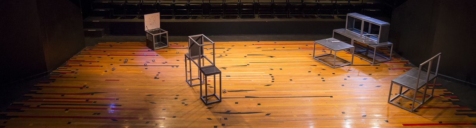 Open, metal blocks on a stage.