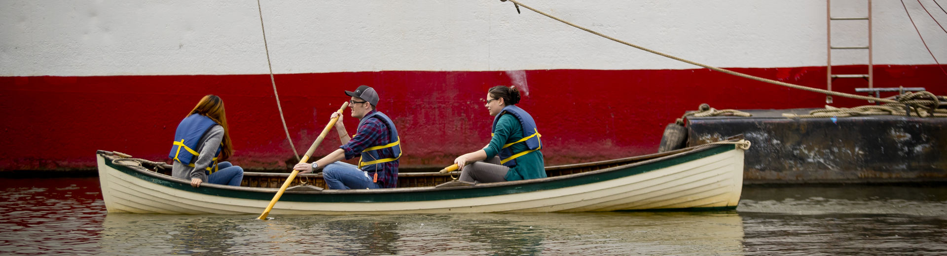 Temple graduate students in the Material Cultures class in a boat at the seaport museum