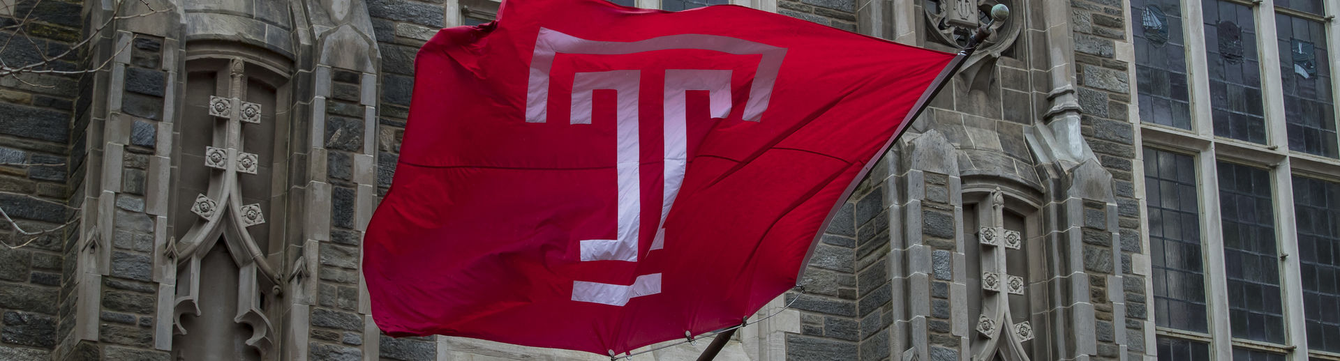 The cherry Temple T flag waves on Main Campus