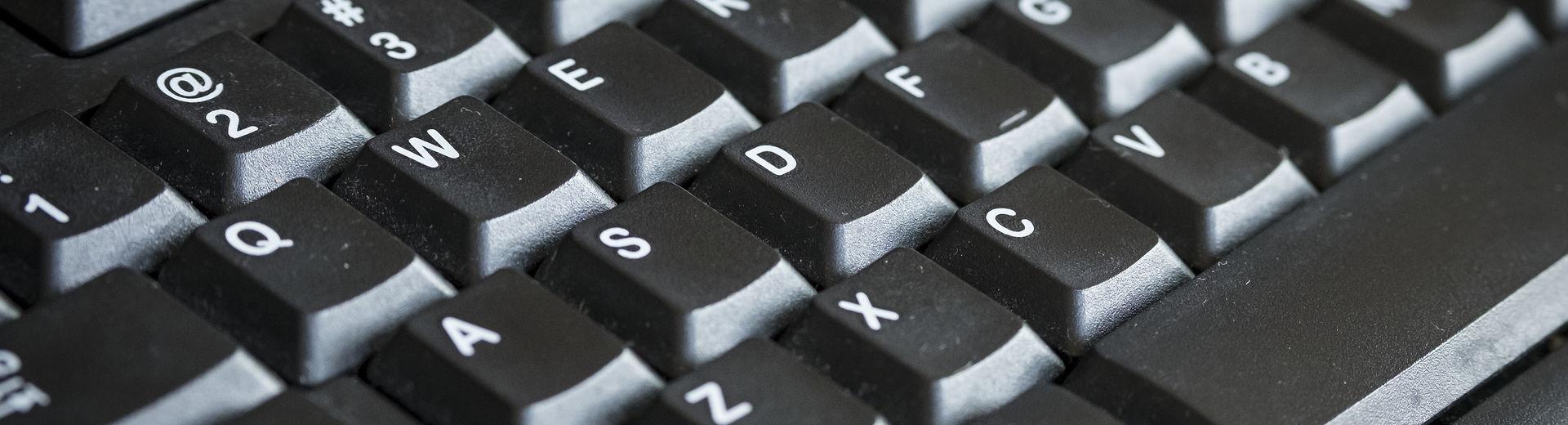 A close-up black computer keyboard.