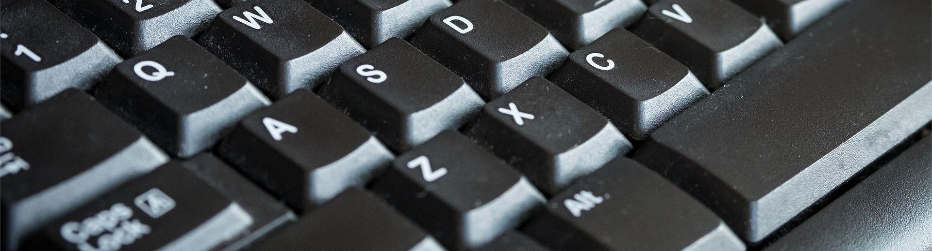 A close-up look of a grey computer keyboard.