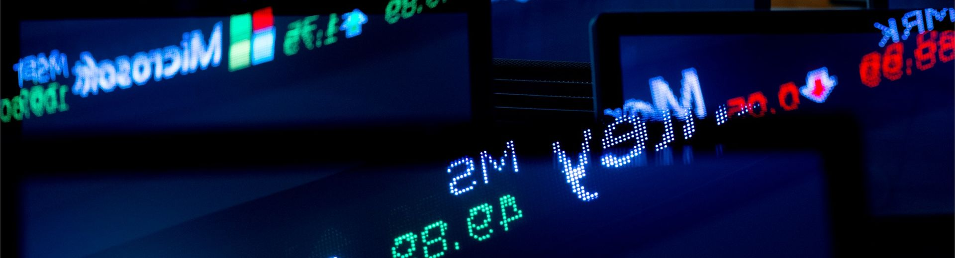 A digital display of Wall Street investment information.