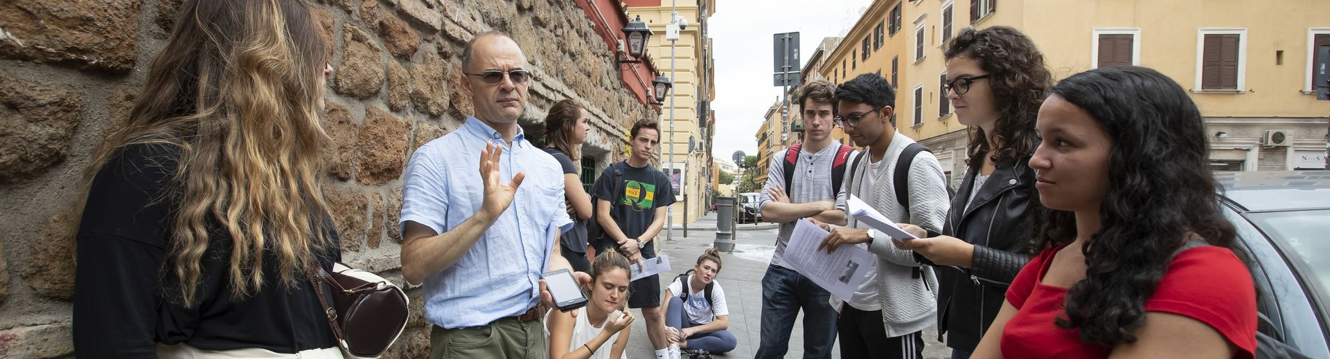 A Temple professor addresses students during a study away program in Rome.