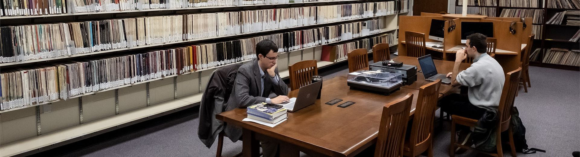 Students working at a long table in the music library.