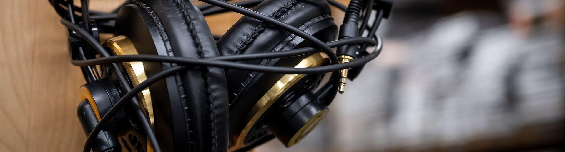 A pair of headphones hangs on a hook.