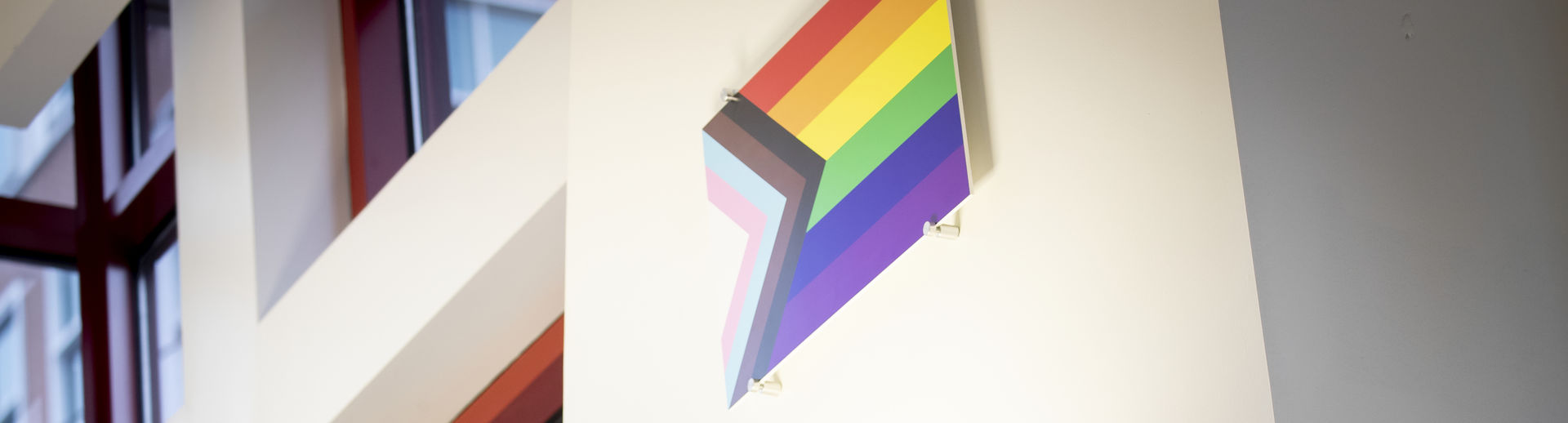The pride flag hangs in the student center of Temple University.