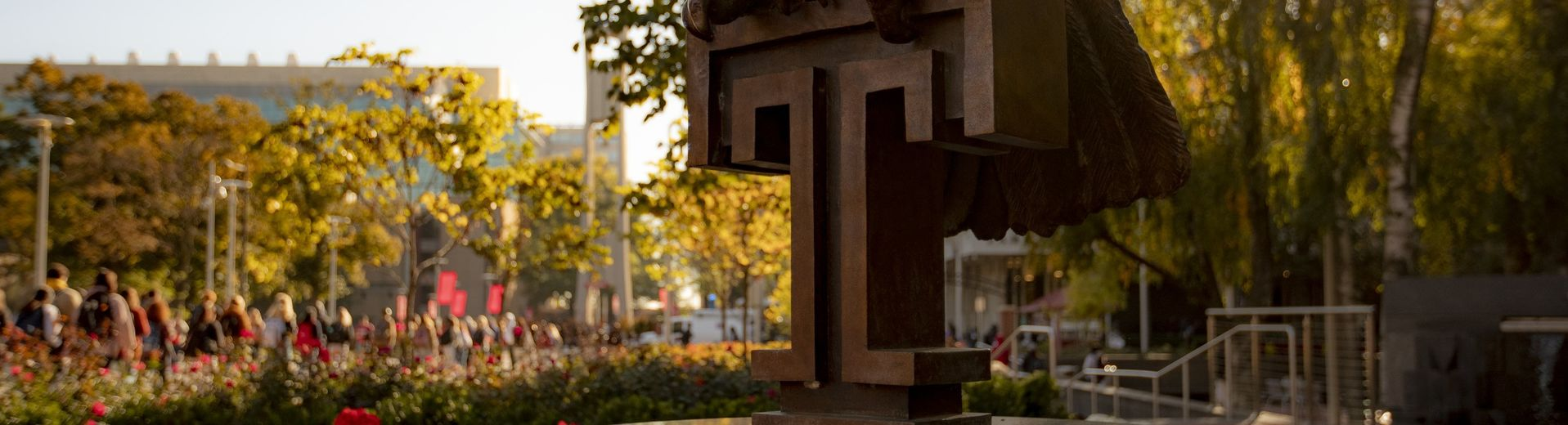 The Temple T and owl statue in O'Connor Plaza at dusk