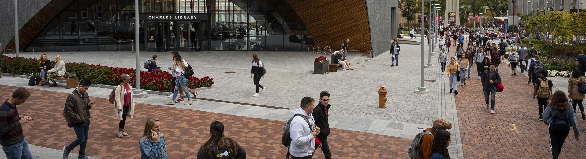 Students walk outside Charles Library on Main Campus