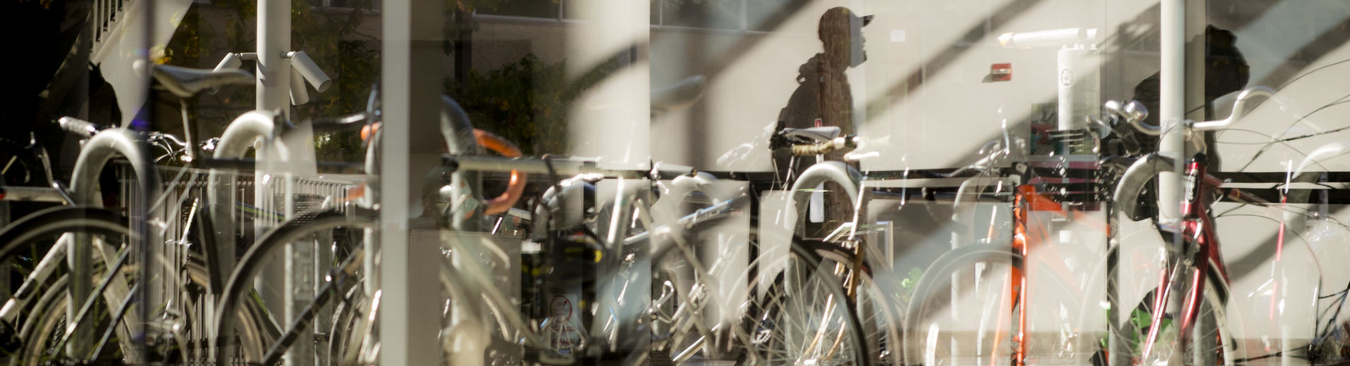 abstract image of bicycles parked outside a building on Main Campus.