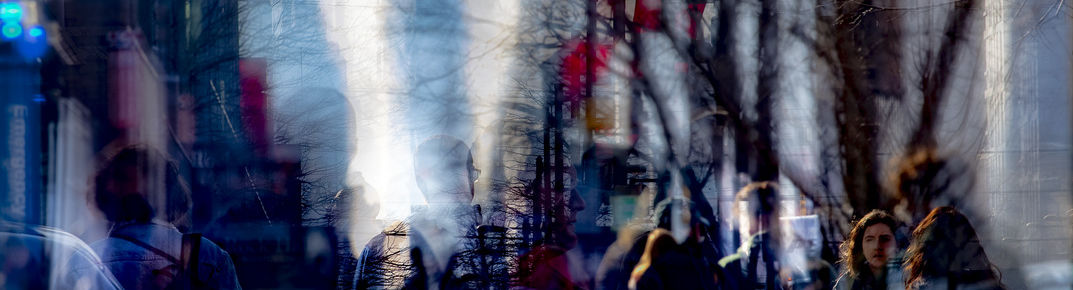A multiple exposure shot of students on Temple's campus.