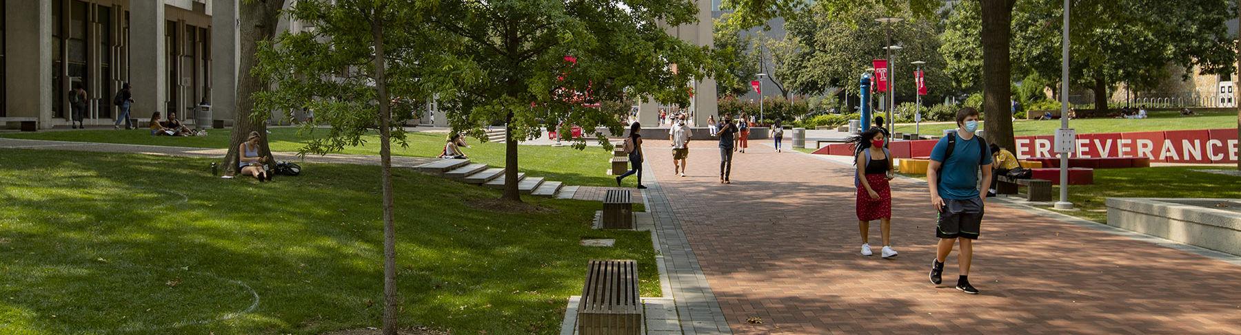 Students on Polett Walk on a sunny summer day