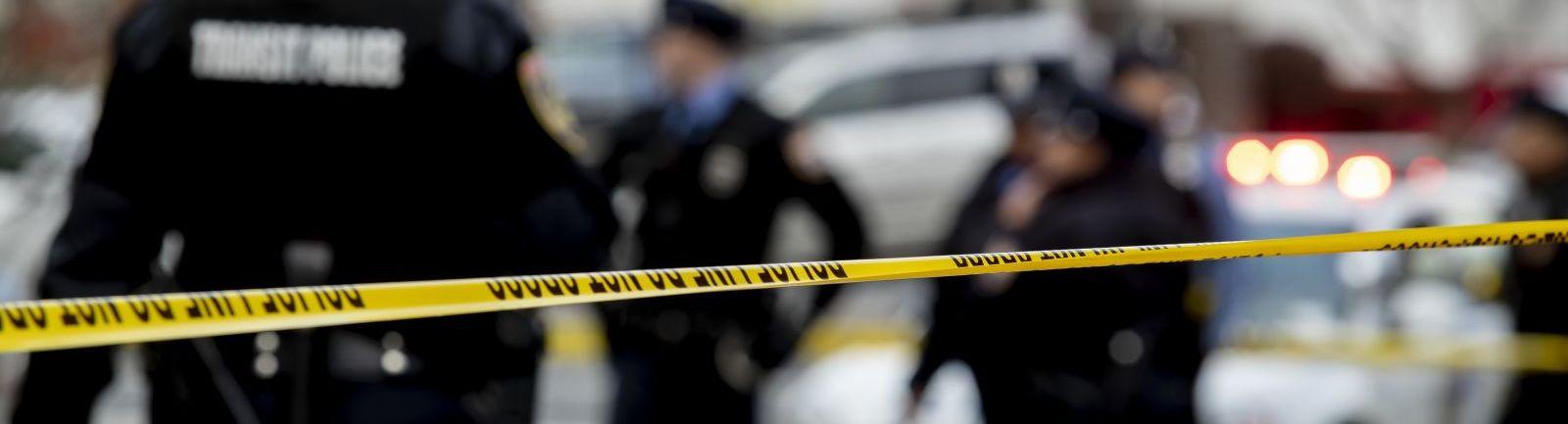 "Police cordon off a crime scene using yellow ""police tape."""