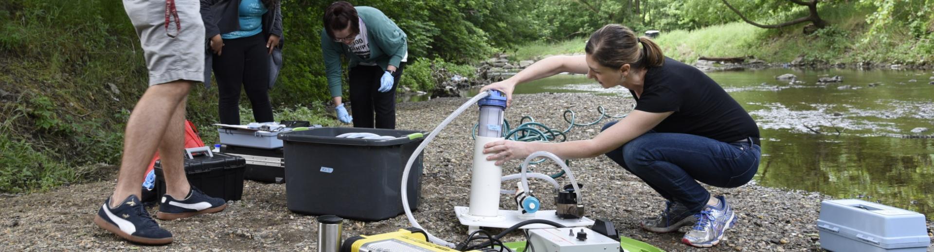 Environmental health class testing river water