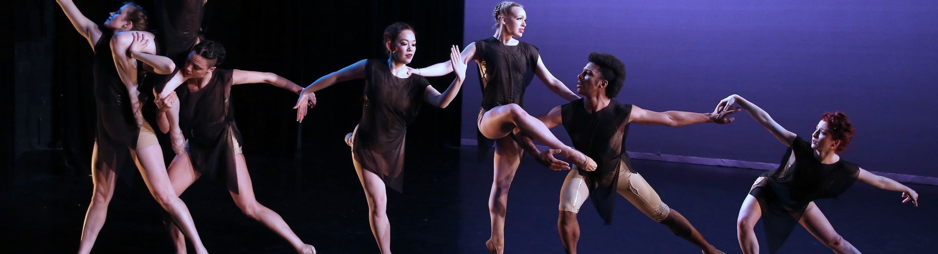 Dancers perform on a stage.