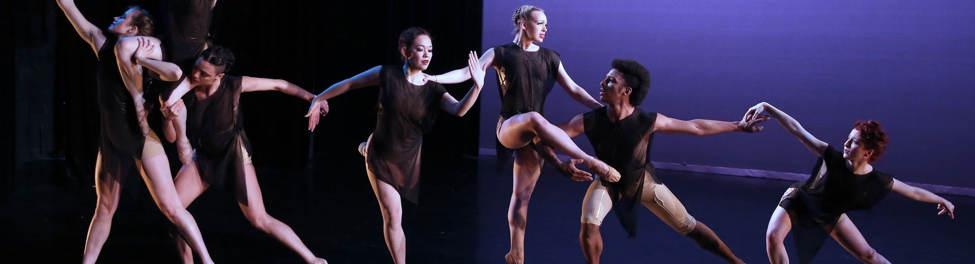 Dancers perform on stage.