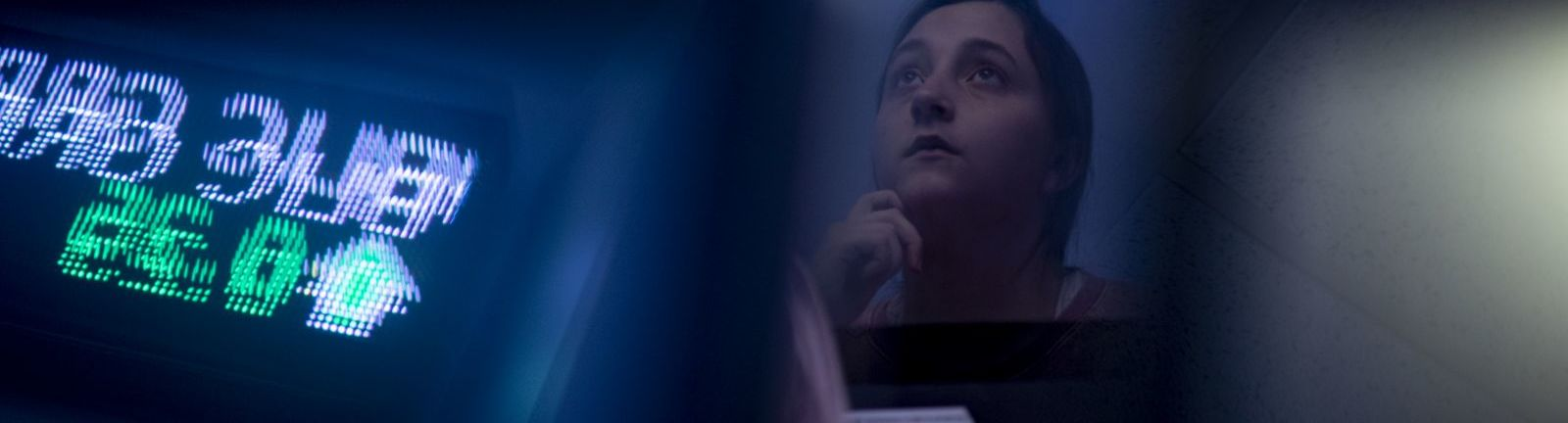 A Fox student listens intently to a lecture on finance.