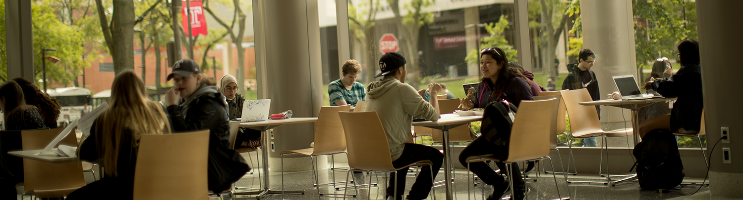 Students sitting and talking on Temple campus
