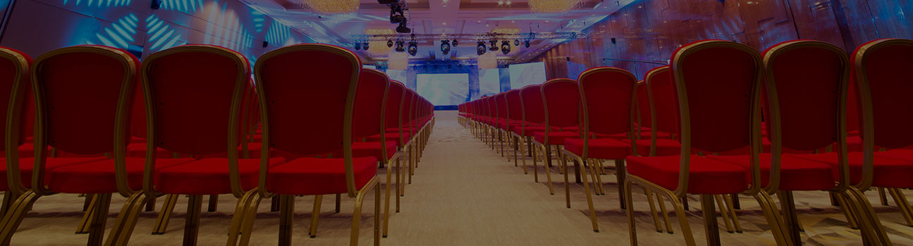 An event space filled with rows of empty chairs.