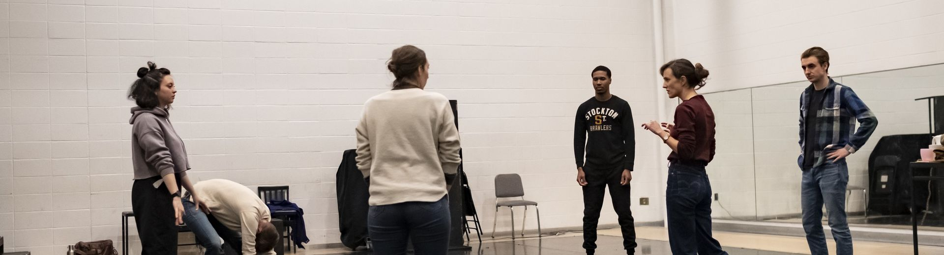"""A group of students discuss a scene from the play, """"Somewhere."""""""