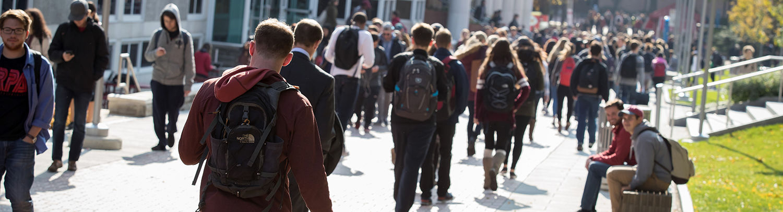 Students between classes walking on Liacouras Walk