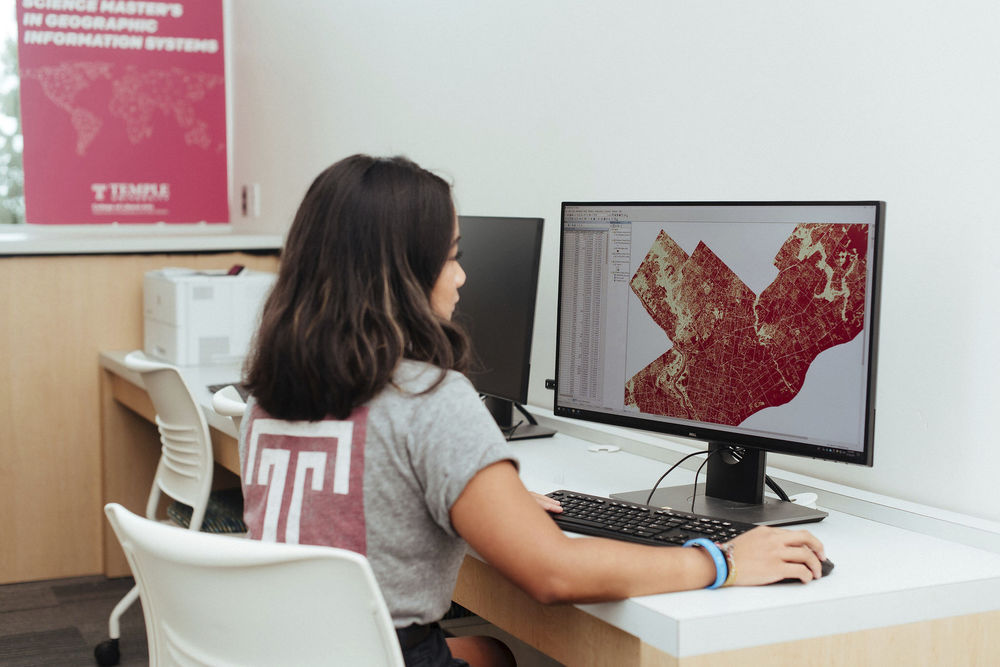 A student works on a mapping project in the GIS studio.