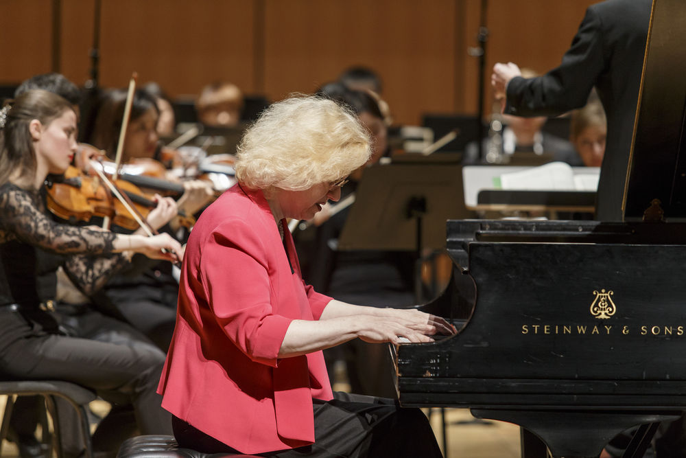 Sara Davis Buechner plays piano with a large ensemble.