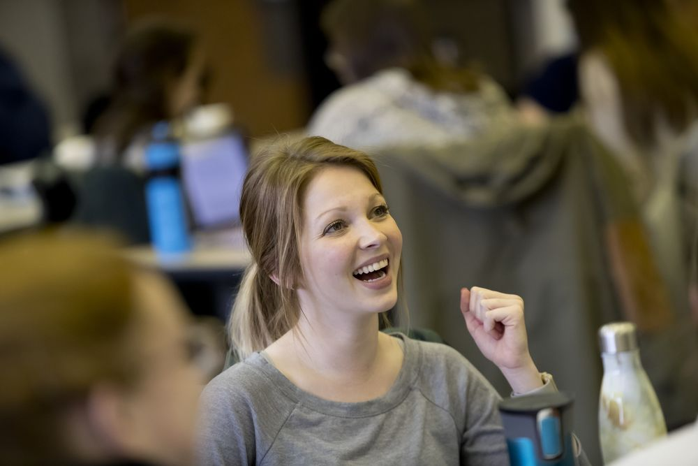 An occupational therapy student laughs during class.