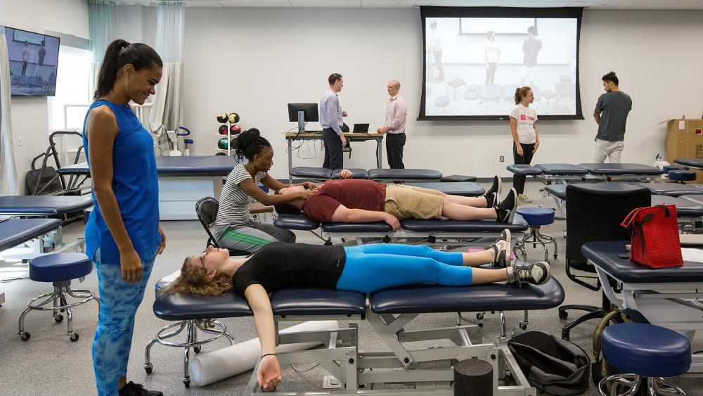 Physical therapy students in clinical practice space