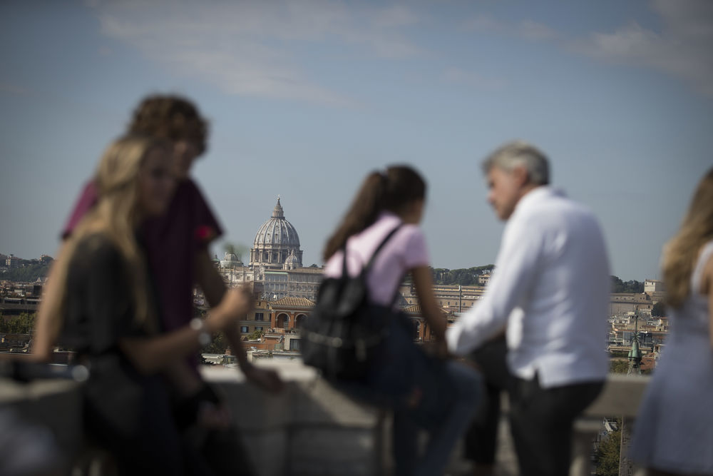 Tourists gather on a rooftop in Rome, Italy.