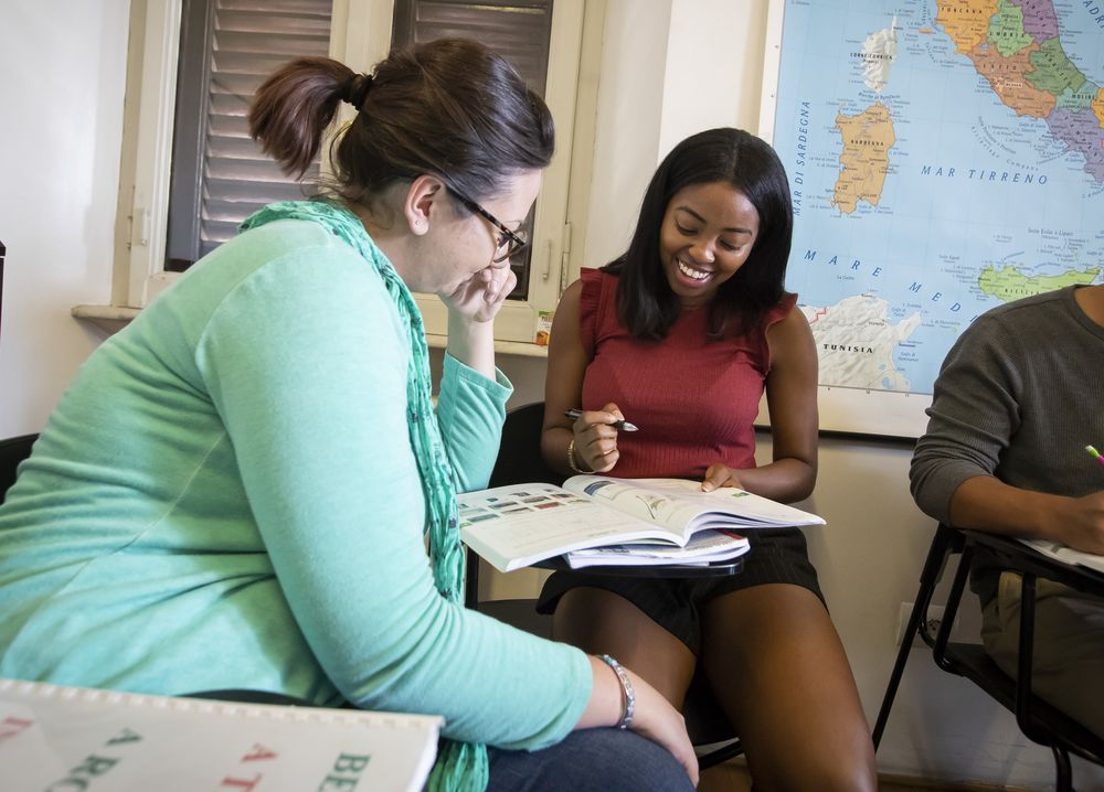 Two students engaging in a foreign language class at Temple University.