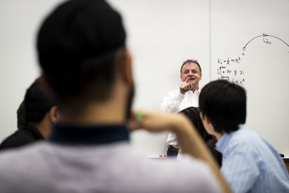 Physics professor lecturing to an undergraduate class