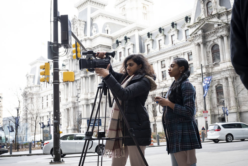 Journalism students setting up a shoot at Philadelphia City Hall.