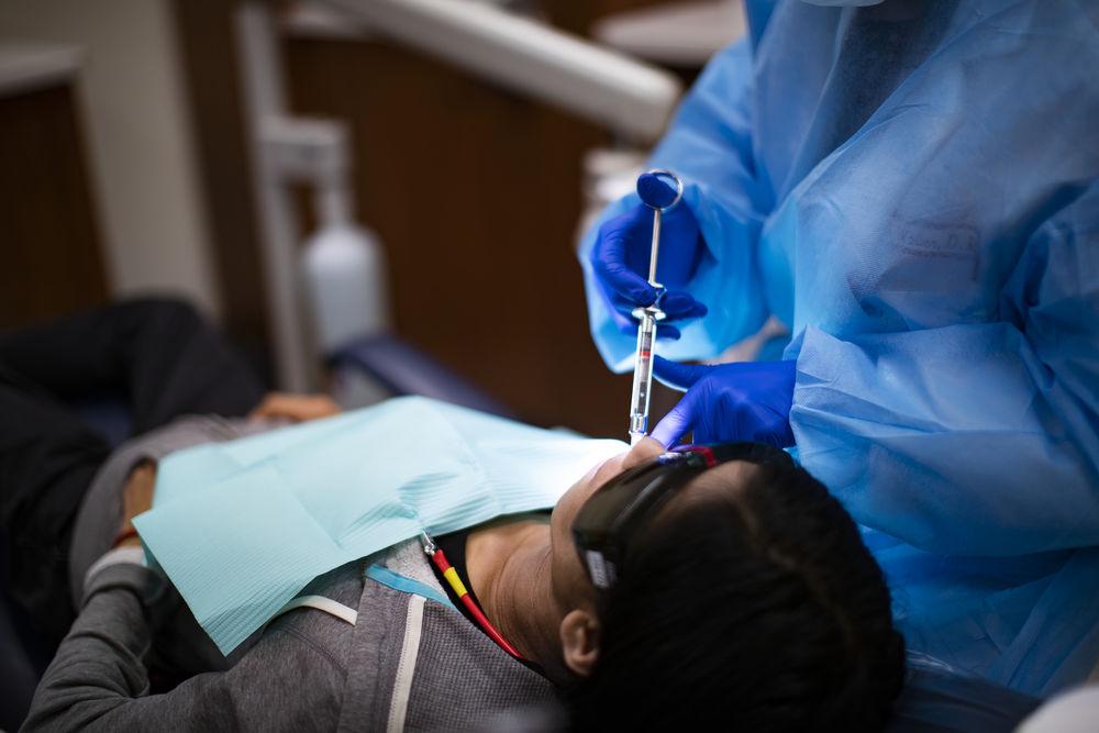 A patient in the Kornberg School of Dentistry receiving periodontics work.