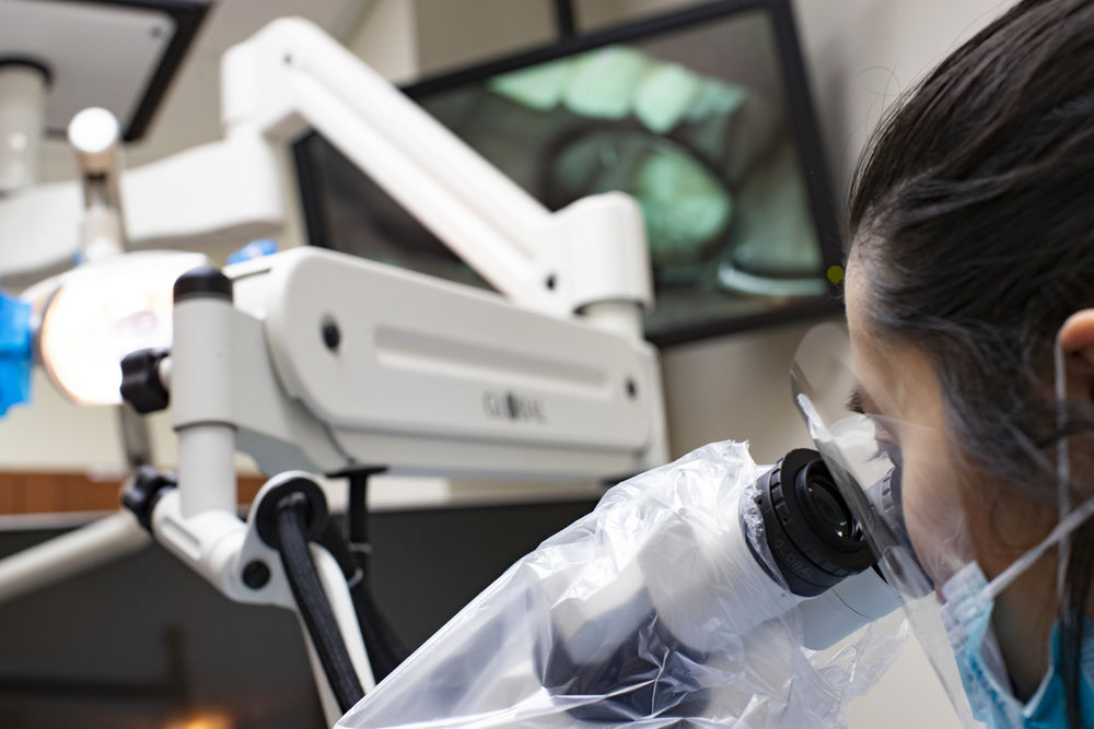 An Endodontics graduate certificate student working in a clinic.
